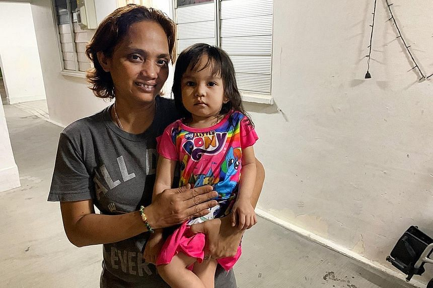 Madam Siti Aisah and her three-year-old daughter Syahirah, who was knocked down by a rider on a personal mobility device while she was playing in a Housing Board flat corridor in Boon Lay Drive on Sunday night. A screengrab of the viral video which s