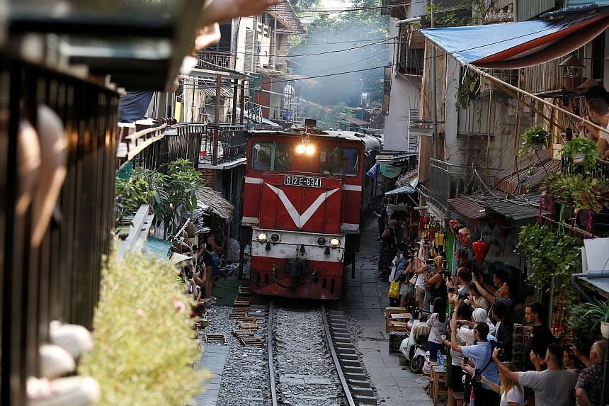 Built in 1902 under French colonial rulers, the railway from Hanoi to Vietnam's northern provinces carries passengers and cargo. The authorities have set a Saturday deadline for the removal of the cafes lining the tracks, citing safety concerns.