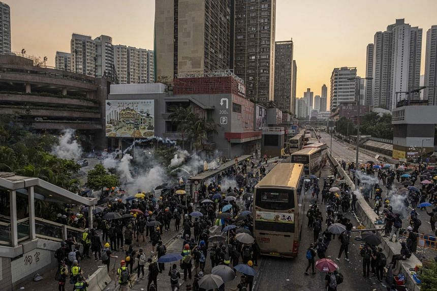 Riot police officers clash with protesters near Wong Tai Sin MTR station in Hong Kong, on Oct. 1, 2019.