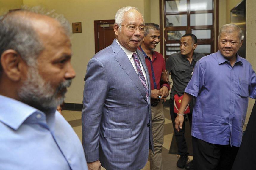 Former Malaysian Prime Minister Najib Razak (centre, in grey) arriving at Kuala Lumpur High Court in Kuala Lumpur on Oct 9, 2019.