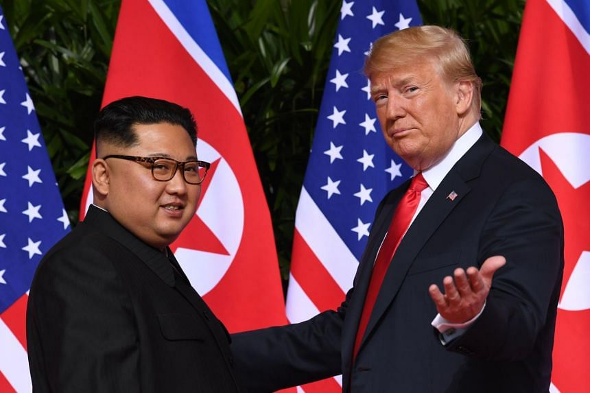 North Korea's leader Kim Jong Un and US President Donald Trump meeting at the start of their summit in Singapore on June 12, 2018.