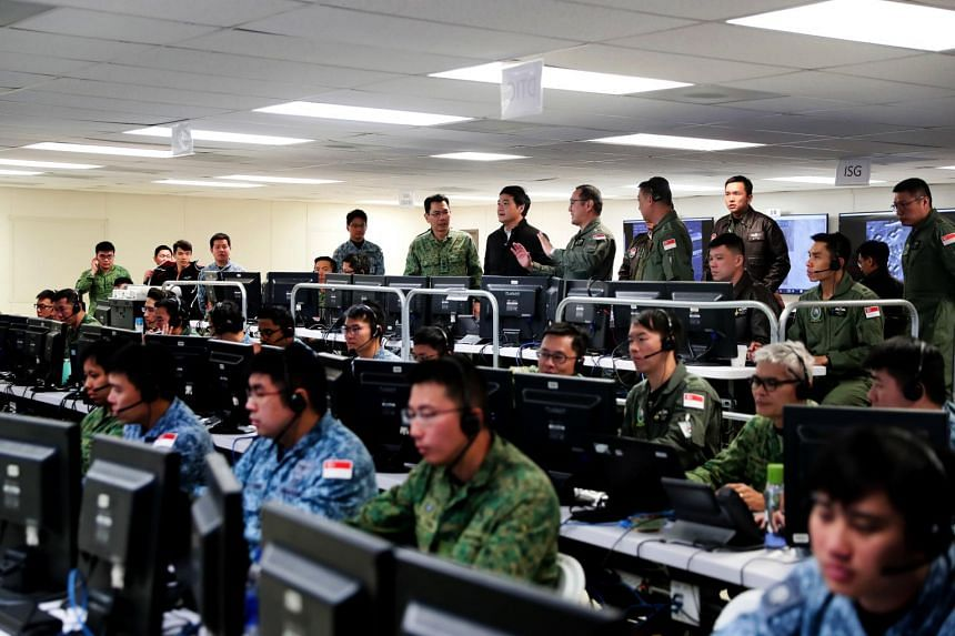 Senior Minister of State for Defence Heng Chee How (back row centre, in black) at the command post for Exercise Forging Sabre, at Mountain Home Air Force Base in Idaho on Oct 9, 2019.