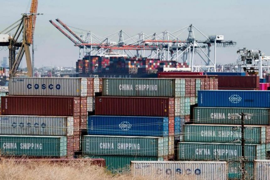 Shipping containers from China and other Asian countries are unloaded at the Port of Los Angeles in Long Beach, California on Sept 14, 2019. PHOTO: AFP