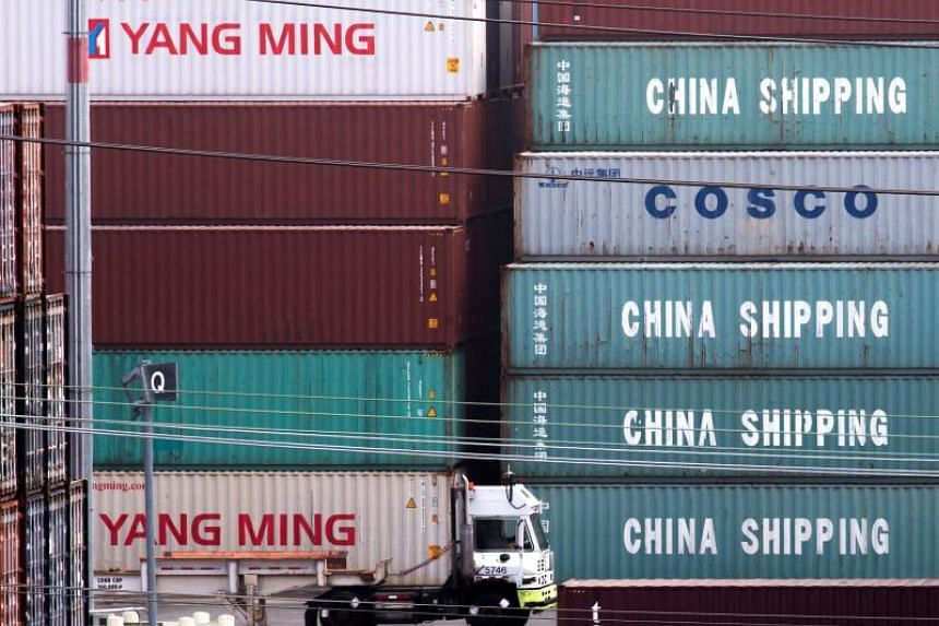In this photo taken on Sept 1, 2019, a truck passes by China Shipping containers at the Port of Los Angeles.