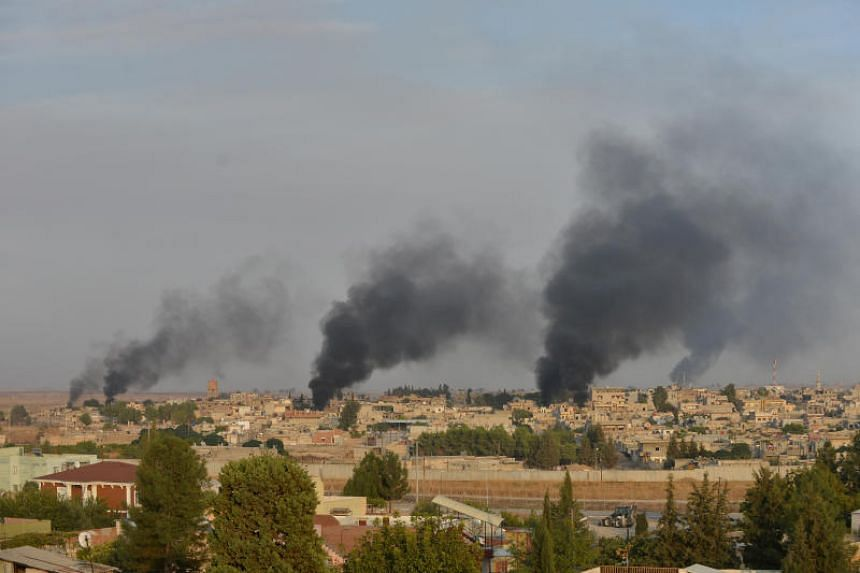 Smoke rises from the Syrian border town of Ras al-Ain as it is pictured from the Turkish town of Ceylanpinar in Sanliurfa province, Turkey on Oct 9, 2019.