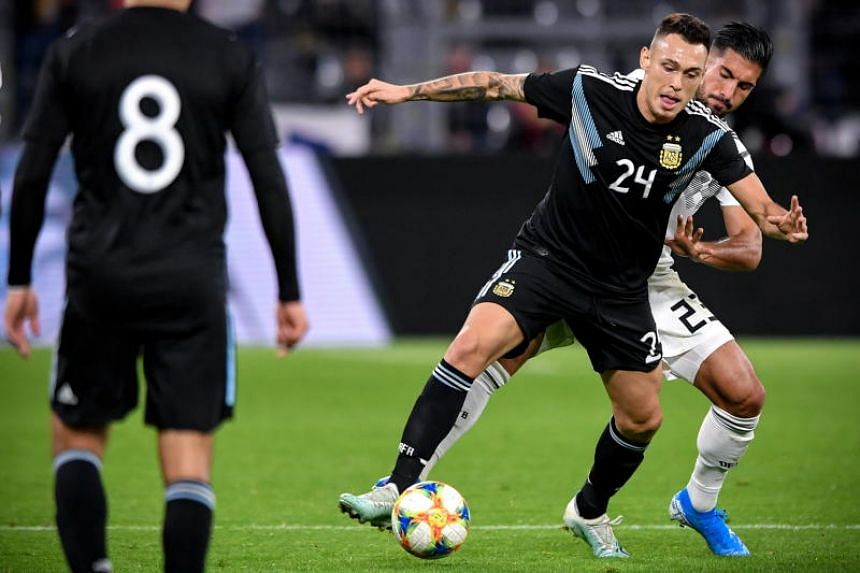 Argentina's Lucas Ocampos (centre) in action against Germany's Emre Can (right) during the international friendly soccer match between Germany and Argentina in Dortmund, Germany on Oct 9, 2019.