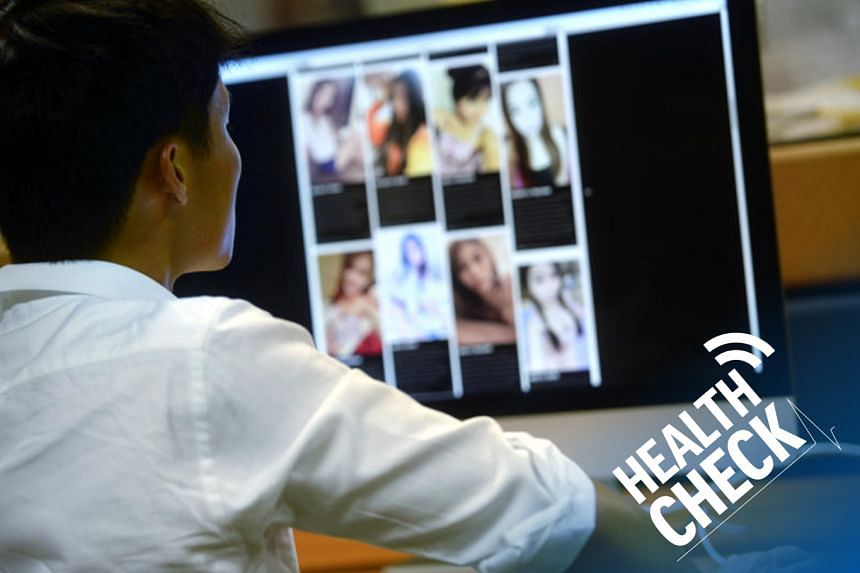Posed photo of a man watching online sex sites and forums.