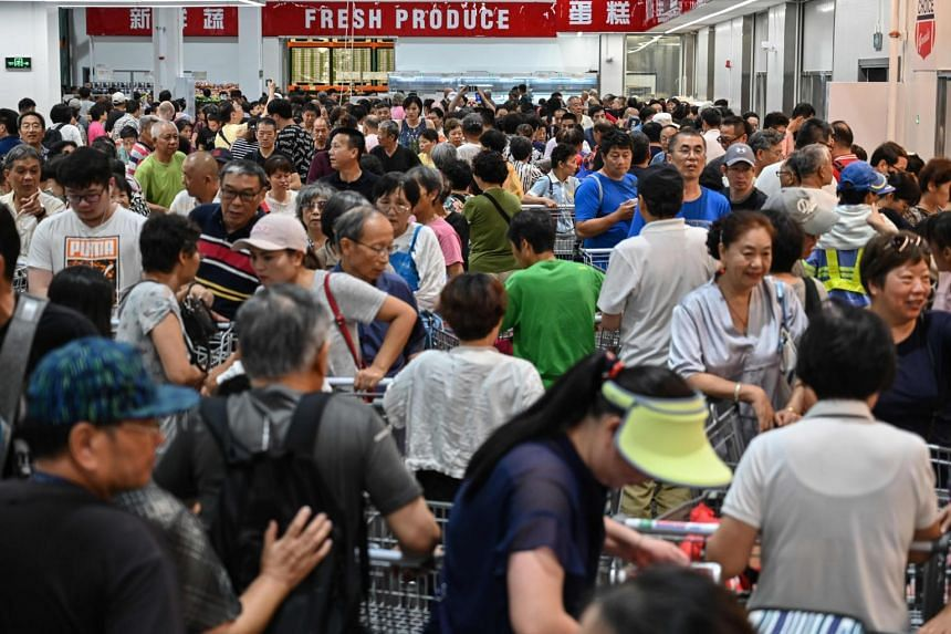 Patrons at a supermarket in Shanghai, China, on Aug 27, 2019.