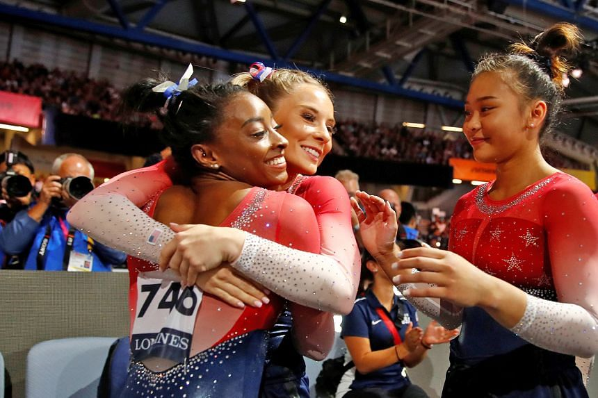 Top: Nikita Nagornyy displaying his prowess on the high bar to seal the men's team gold for Russia, the first European country to win the title since 2001. Simone Biles celebrating with her US teammates Jade Carey and Sunisa Lee after clinching the f