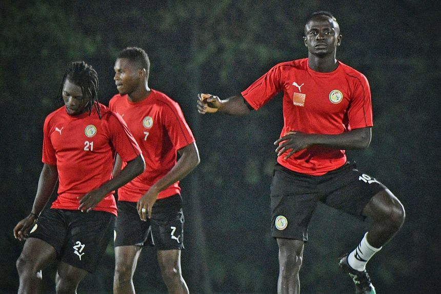 Senegal's team, with Sadio Mane in their ranks, training at Bukit Gombak Stadium yesterday. They will take on Copa America champions Brazil at the National Stadium today. ST PHOTO: ARIFFIN JAMAR