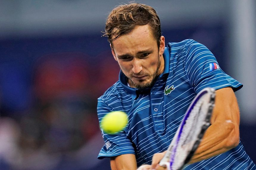 Daniil Medvedev hitting a return to Briton Cameron Norrie at the Shanghai Masters on Tuesday. The Russian won in straight sets. PHOTO: REUTERS
