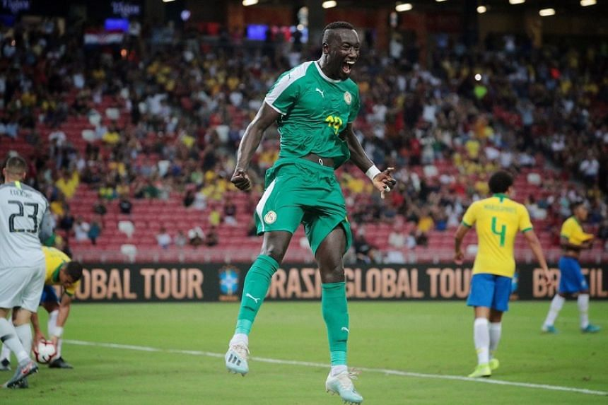 Senegal's Famara Diedhiou celebrates after converting a penalty kick during the international friendly football match against Brazil at the National Stadium in Singapore on Oct 10, 2019.