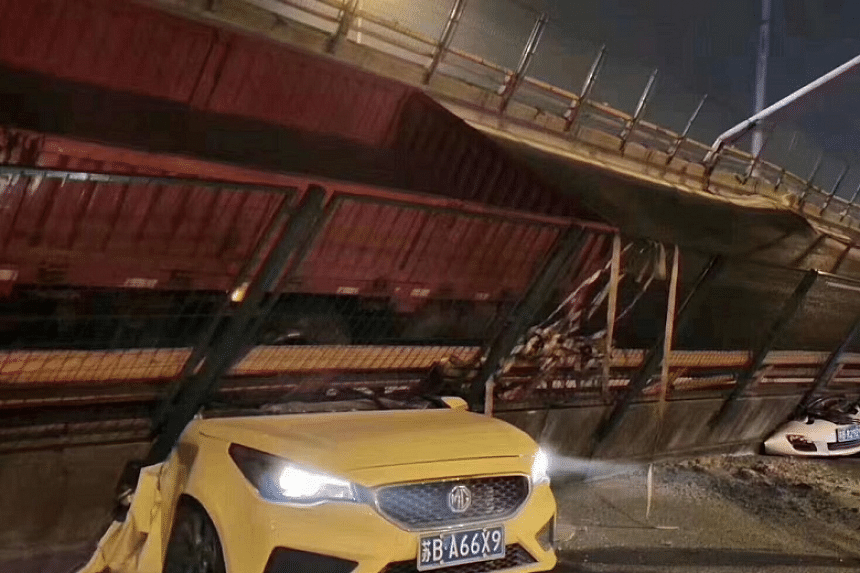 Dramatic images post on social media showed crushed cars, with only their front sections or headlights visible under a huge block of grey concrete.