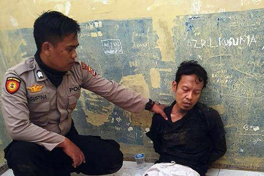 This photo, widely shared on social media, shows one of the two suspects, who have been identified as Syahril Alamsyah and his wife Fitri Andriana.