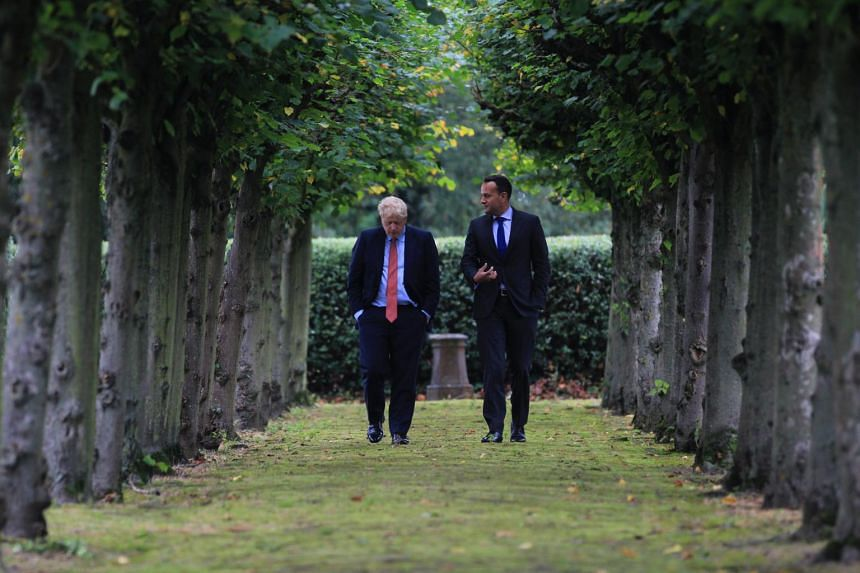 British Prime Minister Boris Johnson and his Irish counterpart Leo Varadkar unexpectedly said they had found a pathway to a possible deal at last-ditch talks.