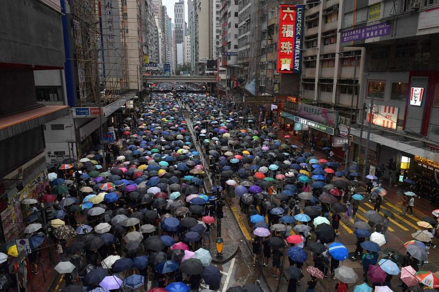 People taking part in a protest march at the Causeway Bay shopping district of Hong Kong, on Oct 6, 2019.