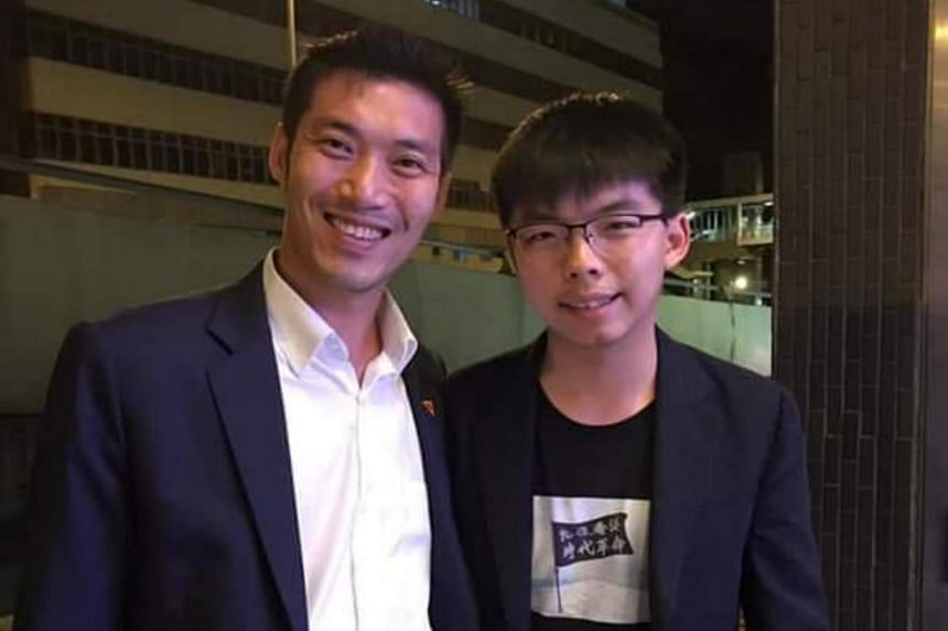 Hong Kong pro-democracy activist Joshua Wong uploaded a picture on Facebook on Oct 6, 2019, showing himself with Mr Thanathorn Juangroongruangkit , who he had met at The Economist magazine's Open Future Festival in the Chinese territory.