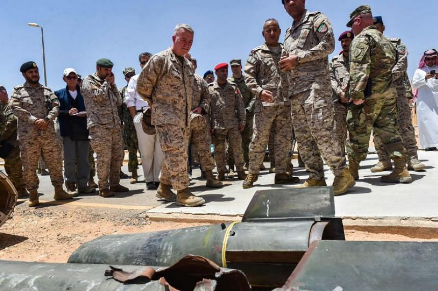 In a photo taken on July 18, 2019, US Marine Corps General Kenneth McKenzie Jr (7th from left) and Lieutenant General Fahd bin Turki bin Abdulaziz al-Saud (6th from left), commander of the Saudi-led coalition forces in Yemen, are pictured during a vi