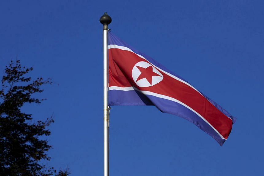 In a file photo taken on Oct 2, 2014, a North Korean flag flies on a mast at the Permanent Mission of North Korea in Geneva, Switzerland.