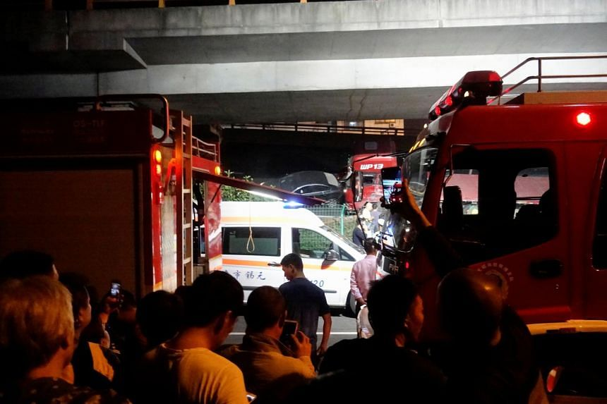 Rescue vehicles and ambulance are seen at the site after a part of highway overpass collapsed in Wuxi, Jiangsu province in China on Oct 10, 2019.