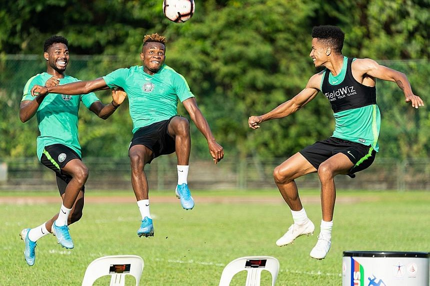 Nigeria players having fun during their training session at the Bukit Gombak Stadium yesterday. The African side will face Brazil at the National Stadium tomorrow as part of the Brazil Global Tour.