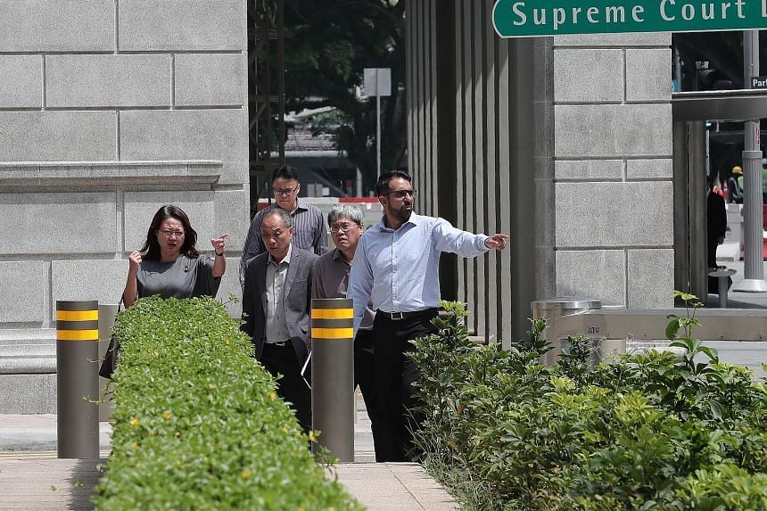 (From left) Workers' Party chairman Sylvia Lim, its former chief Low Thia Khiang, MP Png Eng Huat and current party chief Pritam Singh heading to the Supreme Court on Oct 8 last year for the Aljunied-Hougang Town Council lawsuit. ST FILE PHOTO Justic