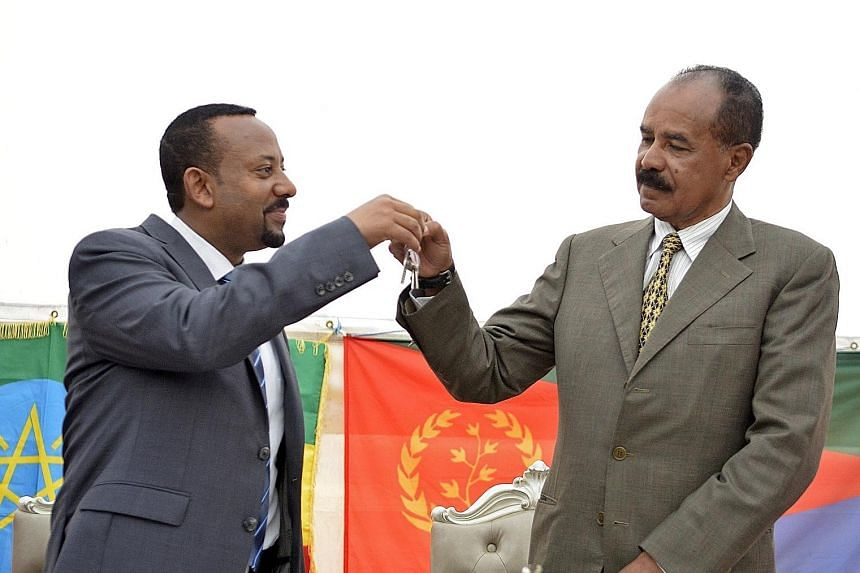 Ethiopia's Prime Minister Abiy Ahmed (left) and Eritrea's President Isaias Afwerki seen here at the re-opening of the Eritrean Embassy in Addis Ababa last year. Mr Abiy had been bookmakers' second favourite to win, behind Swedish teen climate change