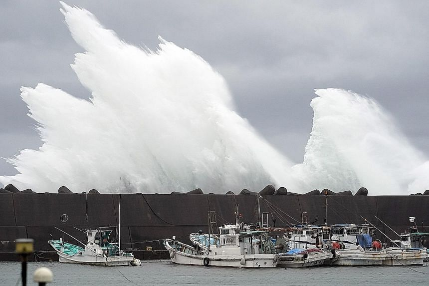 Surging waves generated by Typhoon Hagibis hitting a breakwater at a port in the town of Kiho, Mie prefecture, yesterday. The typhoon is expected to lash central Japan and Tokyo today, affecting transport and major sporting events such as the Rugby W