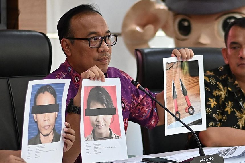National police spokesman Dedi Prasetyo briefing journalists in Jakarta yesterday about the attack on Indonesia's chief security minister Wiranto, who was stabbed twice by a militant on Thursday. PHOTO: AGENCE FRANCE-PRESSE