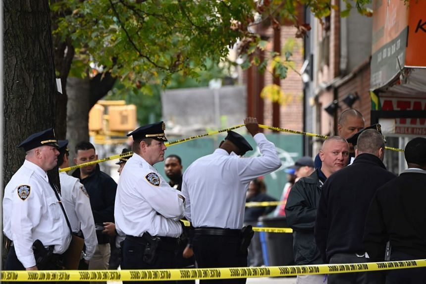 New York police officers securing a crime scene outside a club after a shooting took place on Oct 12, 2019.