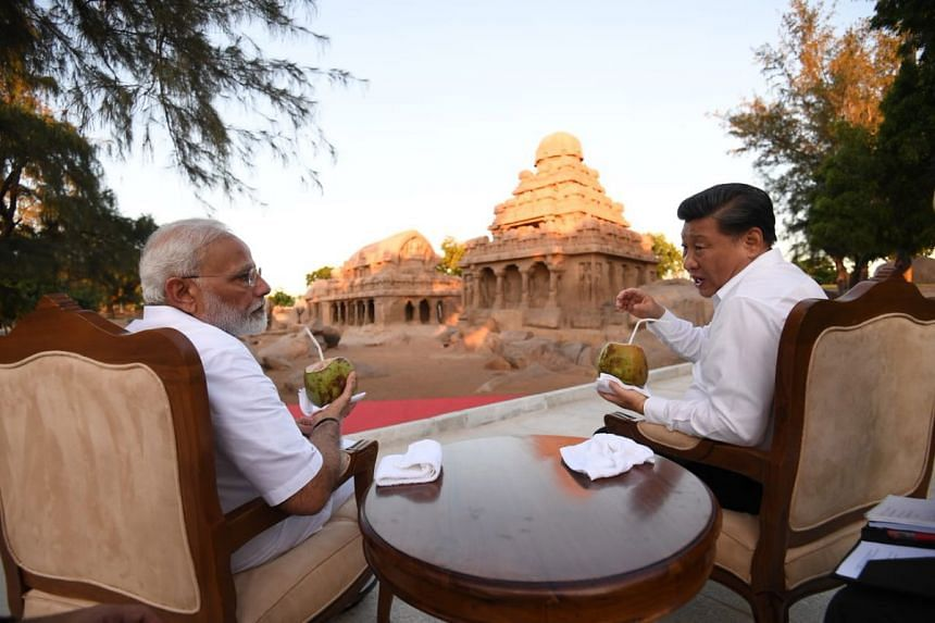 """Chinese President Xi Jinping having a discussion with Indian Prime Minister Narendra Modi at the """"Five Chariots"""" monument in Mamallapuram, India, on Oct 11, 2019."""