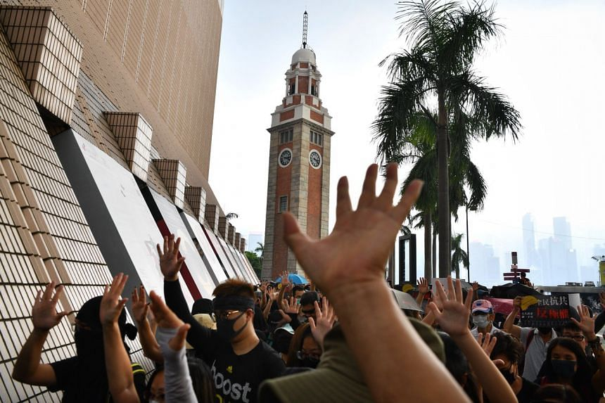 Protesters beginning a demonstration march from Tsim Sha Tsui clock tower on Oct 12, 2019.
