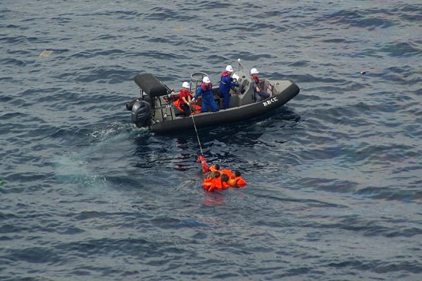 Crew from the Japanese Fisheries Agency patrol boat Okuni rescuing North Korean fishermen from the sea in waters belonging to Japan, on Oct 7, 2019.