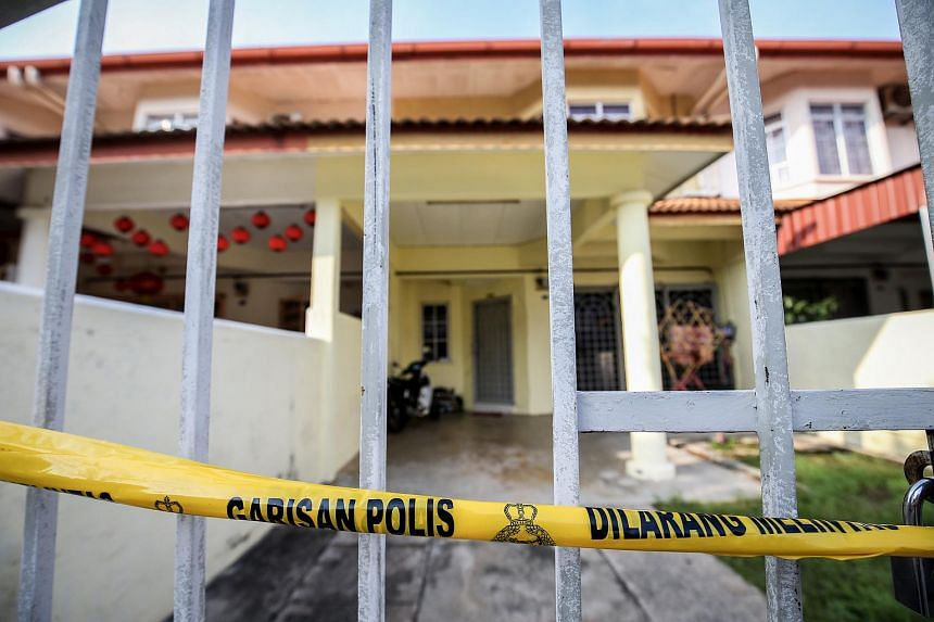 A police line is seen outside the house in Melaka where the Singaporean man allegedly murdered his wife and stepson.