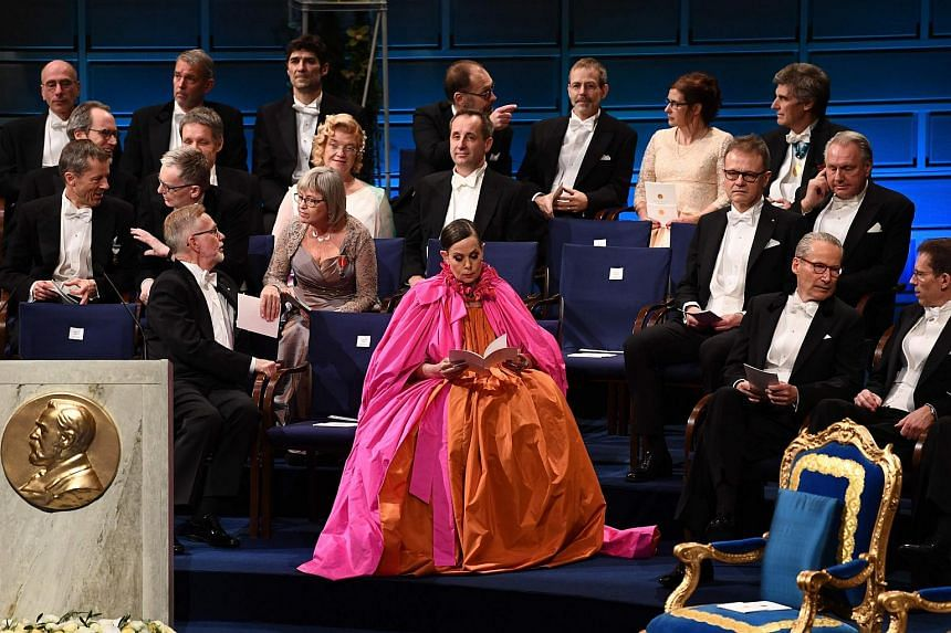 Former Swedish Academy permanent secretary Sara Danius (centre) sitting in the Concert Hall in Stockholm prior to the Nobel Prize Award ceremony on Dec 10, 2018. Ms Danius died aged 57, the academy and her family announced on Oct 12, 2019.