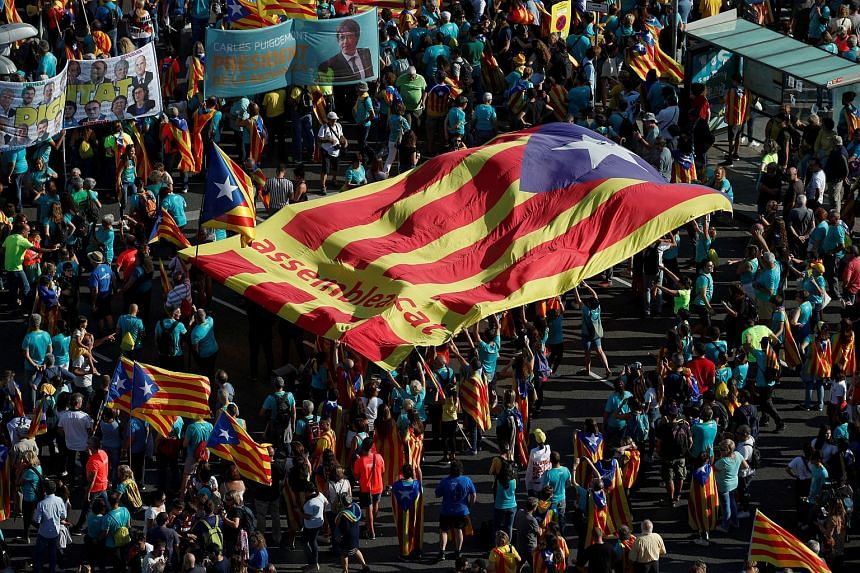 A crowd holding up a giant Catalan separatist flag at a rally on Catalonia's national day, in Barcelona, Spain, on Sept 11, 2019.