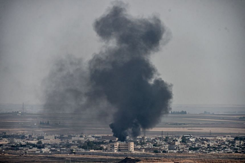 Smoke rising from the Syrian town of Ras al-Ain on Oct 11, 2019, the third day of a Turkish offensive against Kurdish forces in northern Syria.
