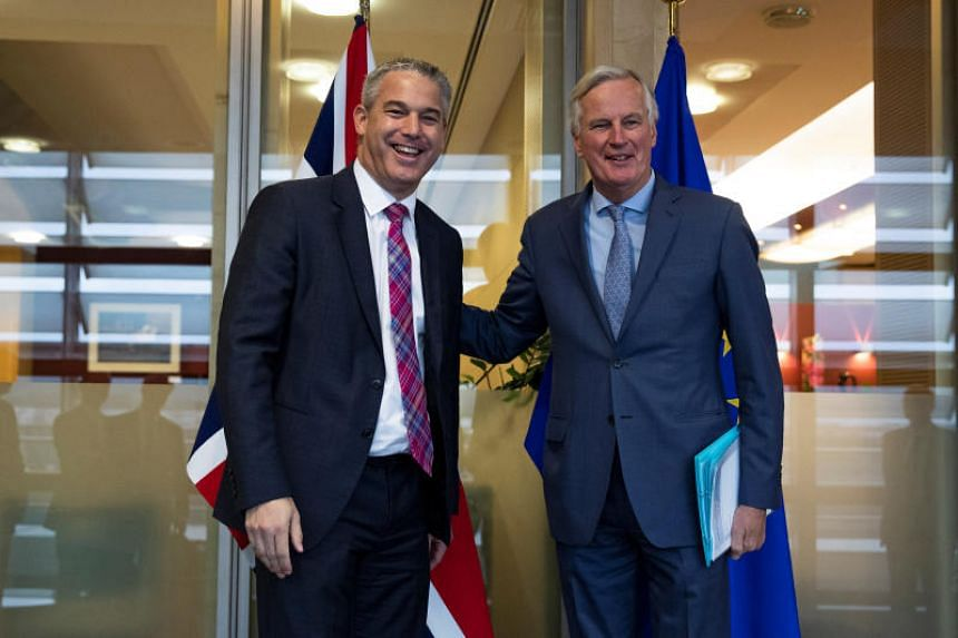 Britain's Brexit Secretary Stephen Barclay (left) poses with European Union's chief Brexit negotiator Michel Barnier ahead of a meeting at the EU Commission headquarters in Brussels, Belgium on Oct 11, 2019.