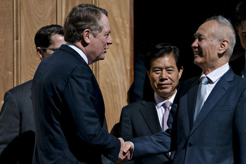 Chinese Vice-Premier Liu He (right) shakes hands with US Trade Representative Robert Lighthizer (left) after a meeting at the Office of the USTR in Washington, DC, Oct 11, 2019.