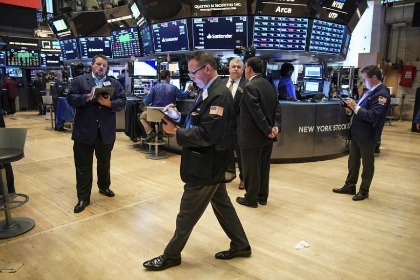 Traders and financial professionals work at the closing bell on the floor of the New York Stock Exchange (NYSE) on Oct 11, 2019 in New York City.