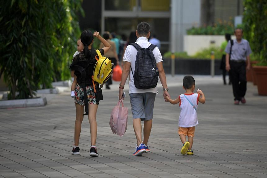 A family with two young children at Toa Payoh Central.