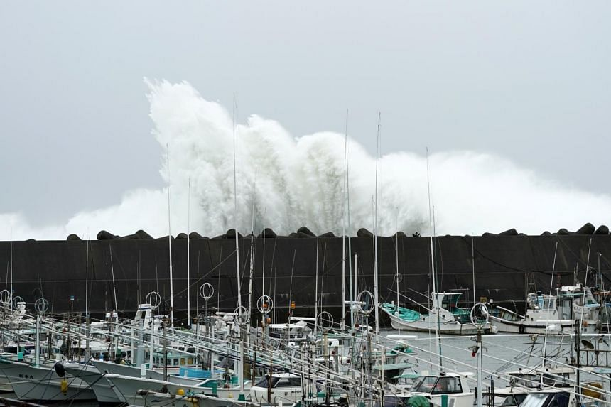 Surging waves generated by Typhoon Hagibis hit against a breakwater at a port in the town of Kiho, Mie Prefecture, Japan, on Oct 12, 2019.