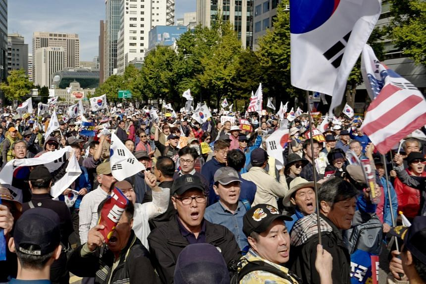 Protesters try to march during a rally against the South Korean government in Seoul, South Korea, on Oct 9, 2019.