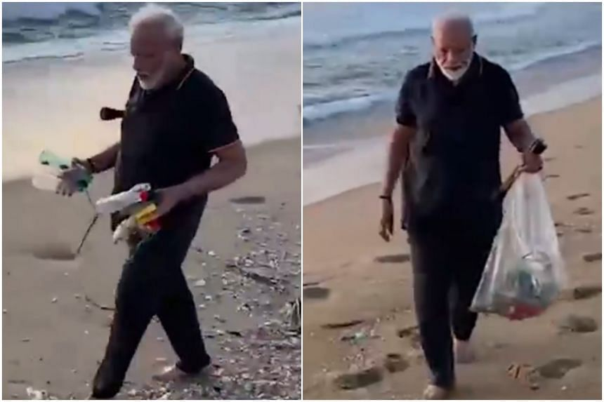 Indian PM Narendra Modi collected plastic bottles - on which he has declared war - as well as banana skins and other litter in a big plastic bag.