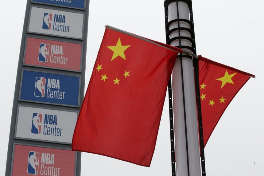 NBA logos are seen next to Chinese national flags outside a NBA-themed lifestyle complex on the outskirts of Tianjin, China, on Oct 10, 2019.