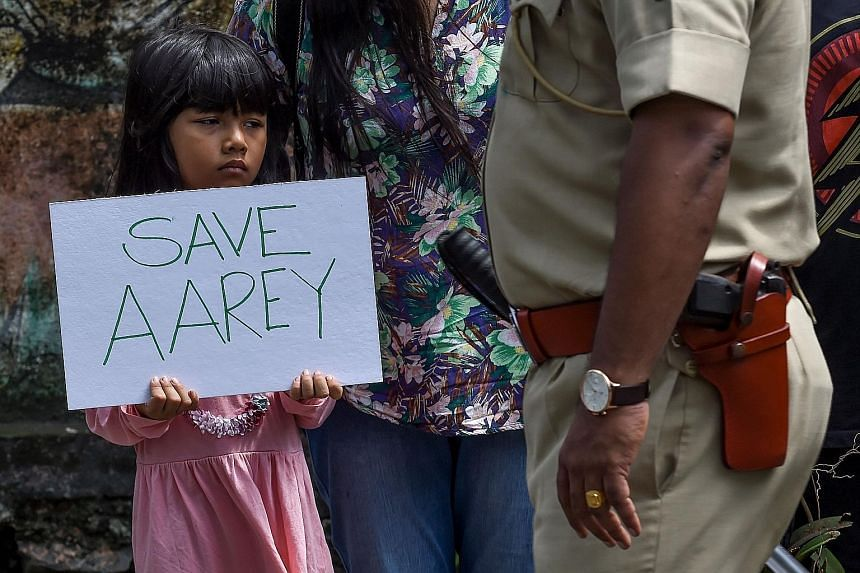 A child protesting last month against the destruction of Aarey forest, a beloved oasis, in Mumbai.
