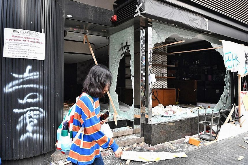 A Starbucks outlet in Kowloon was smashed by protesters yesterday. Protesters have also targeted China banks and shops with perceived links to China.