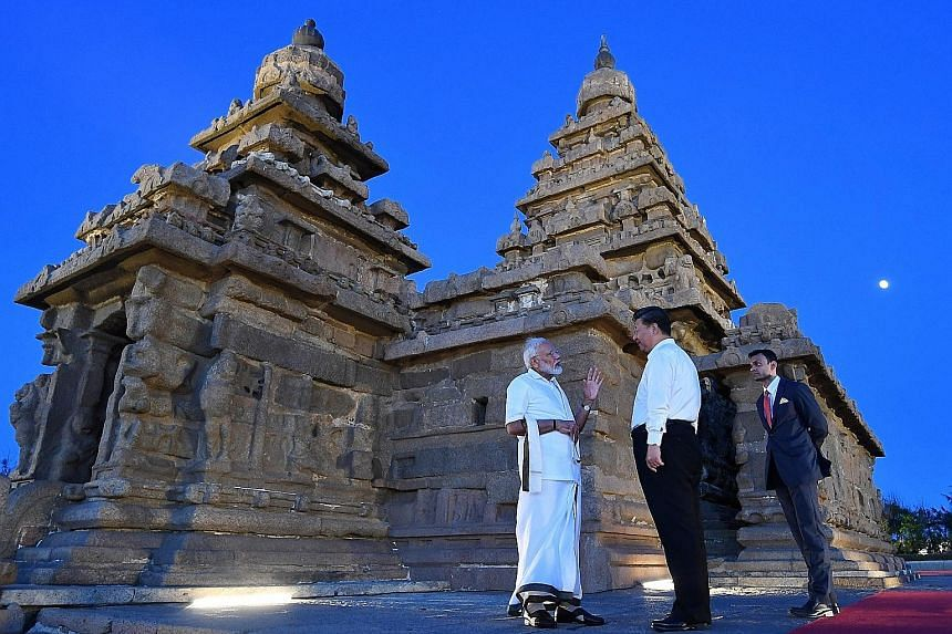Indian Prime Minister Narendra Modi and Chinese President Xi Jinping visiting the Shore Temple in Mamallapuram on Friday during the two leaders' second annual summit in the southern seaside Indian town.