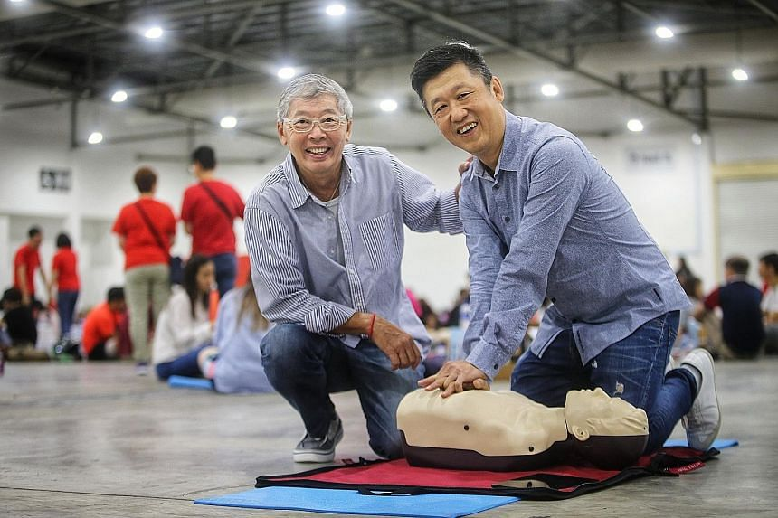 Mr Charleston Chua (left) collapsed after lunch three years ago and his friend Peter See performed cardiopulmonary resuscitation on him until the ambulance came.