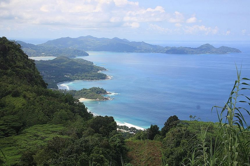 Above: A view of the coastline of the largest island of Mahe. The Seychelles, located east of Kenya, is made up of 115 islands sprinkled across the Indian Ocean. The Aldabra giant tortoise (above) spotted on La Digue island and the double-lobed coco